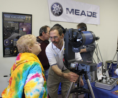 Meade representative demonstrating LightSwitch telescope at Skies Unlimited